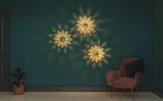 Arame Wall Light with LED bulb looks like a flower on your wall by Tom Raffield