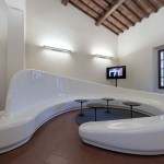 Archetto Seating's Curves And Glossy Finish Will Keep You Sitting