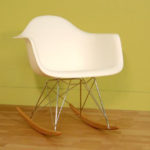 Baxton Studio Letterio White Cradle Chair Features Simple Form Sculpted to Fit Your Body