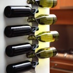Hold Your Wine And Decorate With Your Black Blum Wall Mounted Wine Rack
