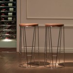 Experience Elegance And Style As You Sit On Forest Bar Stools