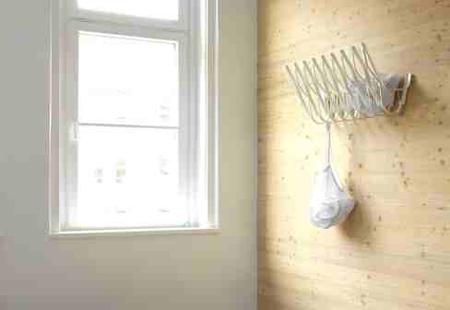 Upon Wall Mounted Coat Hanger